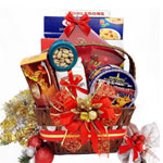 Mind-Blowing Jingle Bell Hamper with Cluster of Chocolates and Cakes